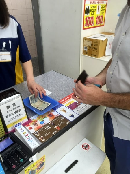 Pay with cash at the Cash Register (note that you must pay within 30 minutes)